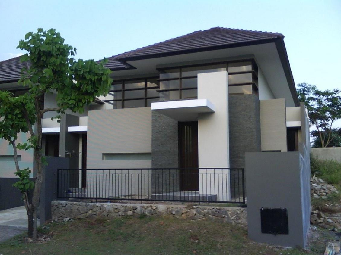 Fachada de casa moderna revestida for Casa moderna 2017