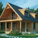 Fachada de casa de madera con balcon