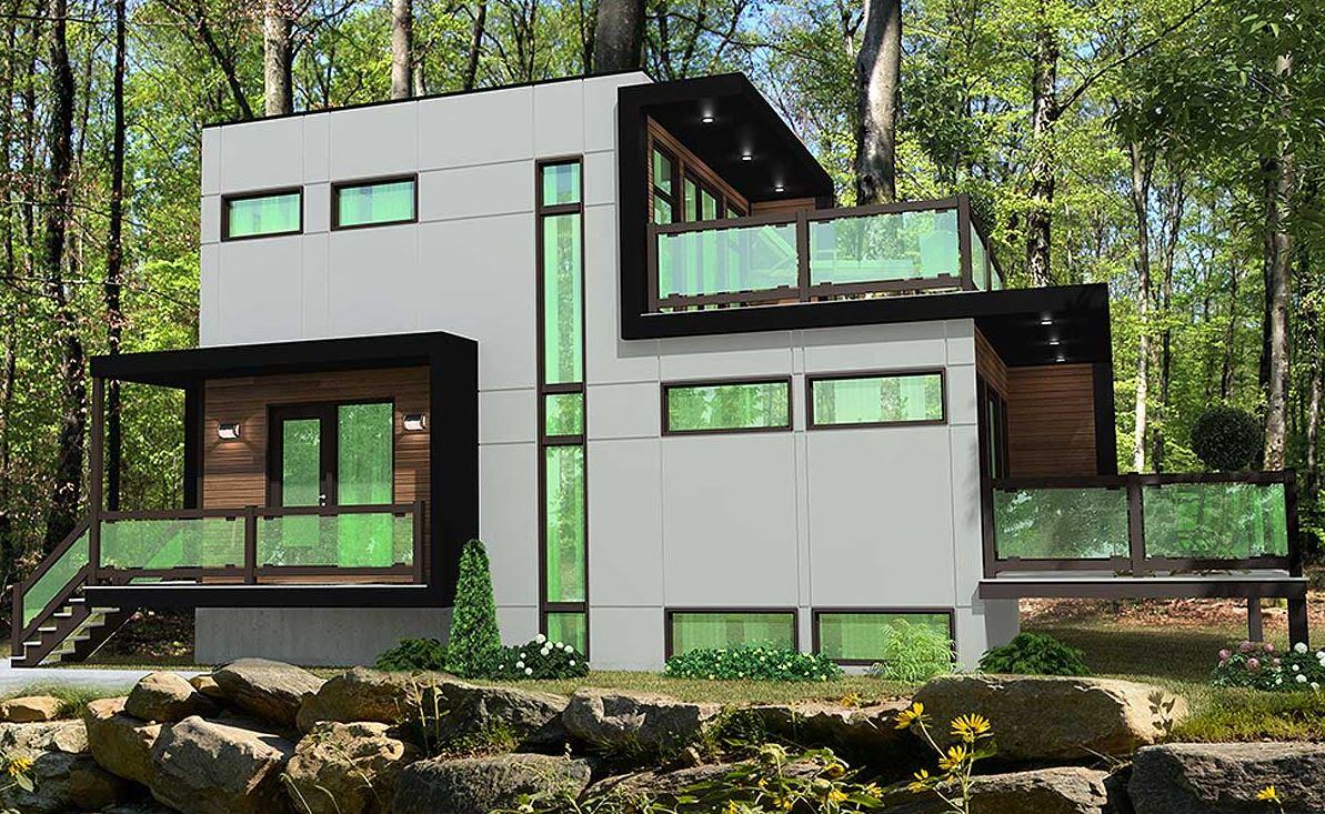 Fachada de casa con vidrios verdes for Fachada de casas modernas con vidrio