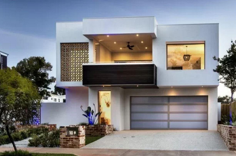 Viviendas modernas fachada de casa moderna de tres pisos for Fachadas de casas e interiores