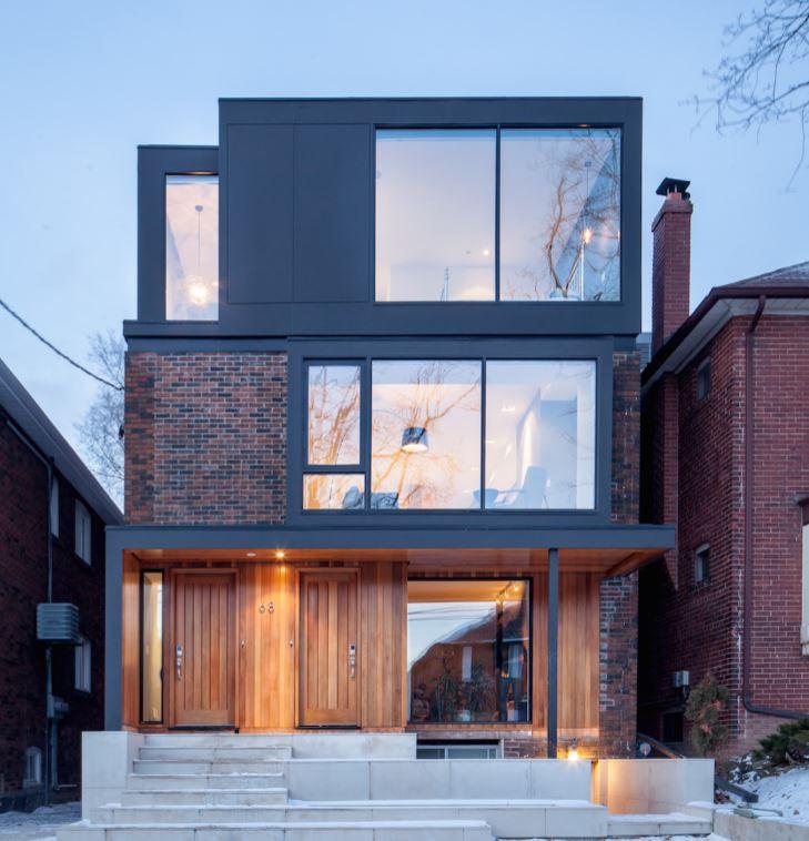 fachadas de casas de tres niveles