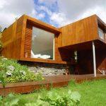 Casa sencilla en madera con fotos del interior
